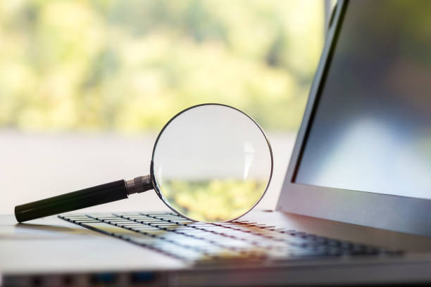 searching on internet concept, magnifier on computer keyboard - dictionary stock pictures, royalty-free photos & images