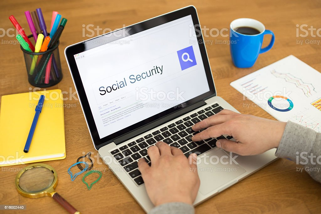 Searching SOCIAL SECURITY on Internet Search Engine Browser Conc stock photo