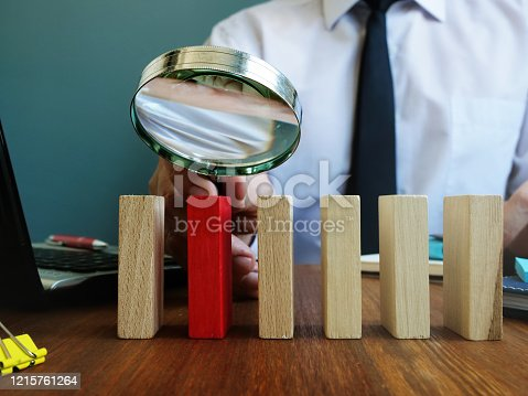 483424715 istock photo Searching talent or employee concept. Recruiter holds magnifying glass. 1215761264