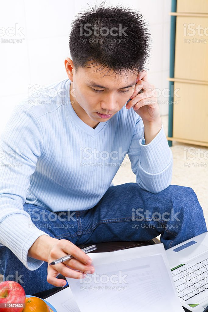 Searching the document while on phone royalty-free stock photo