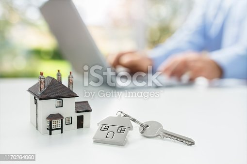 Searching the internet for real estate or new house with model home and key