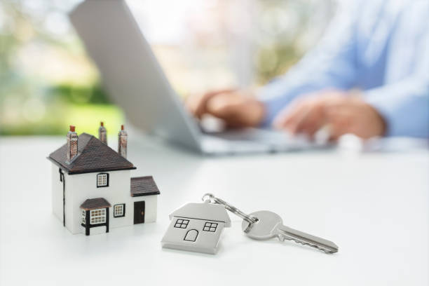 searching the internet for real estate or new house - buy a house key imagens e fotografias de stock