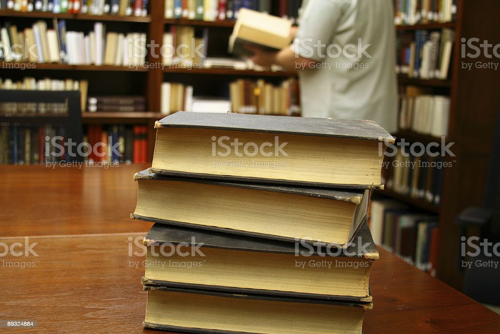 Searching the Stacks: Man at Library Looking for books royalty-free stock photo