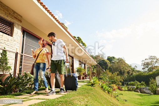 Shot of a traveler couple arriving at their holiday resort