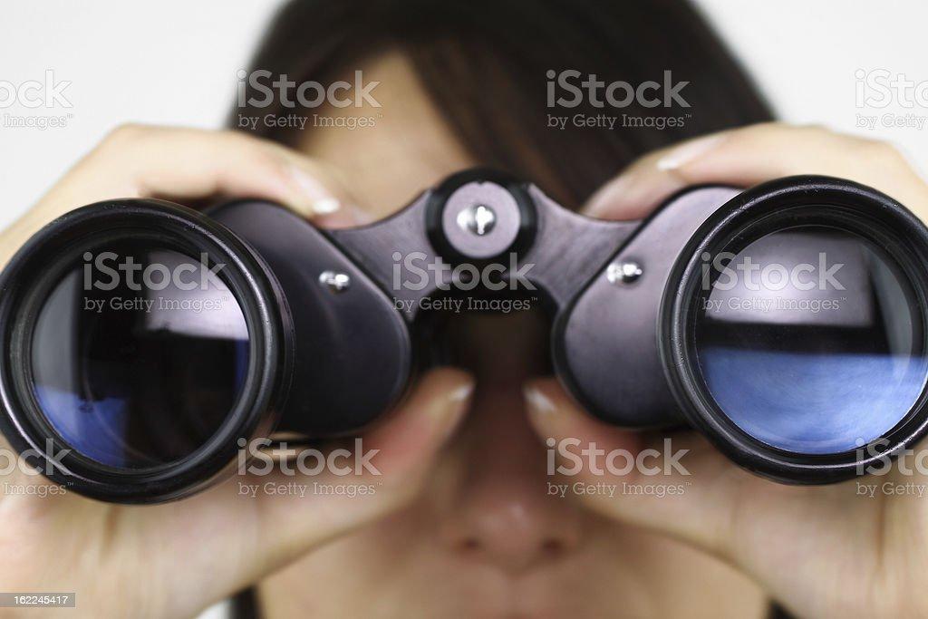 Searching with binoculars stock photo