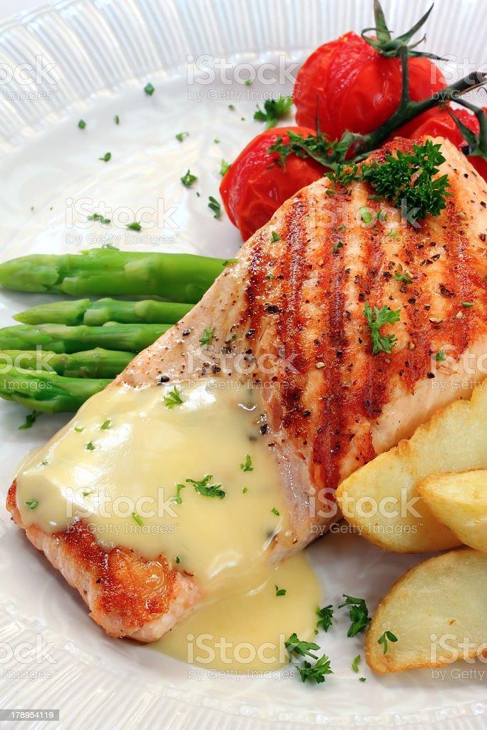 Seared Atlantic salmon with veggies in a hollandaise sauce stock photo