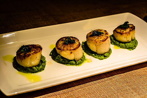 seared scallops as appetiser in italian restaurant - appetiser stock photos and pictures