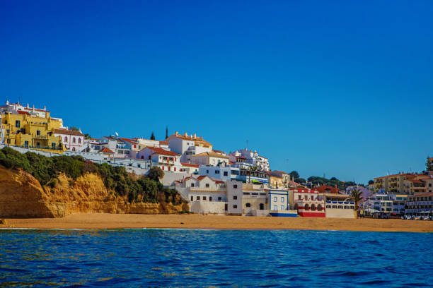 Seascape images of beaches and rock formations in Alvor Portugal in late summer sun stock photo