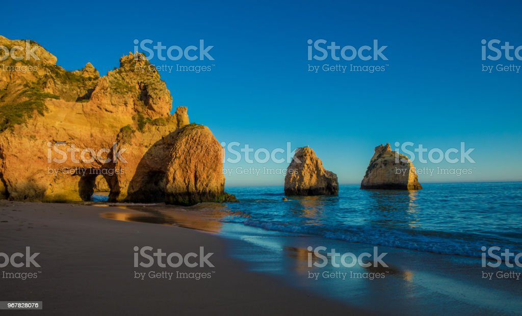 Seascape images of beaches and rock formations in Alvor Portugal in late summer sun - fotografia de stock
