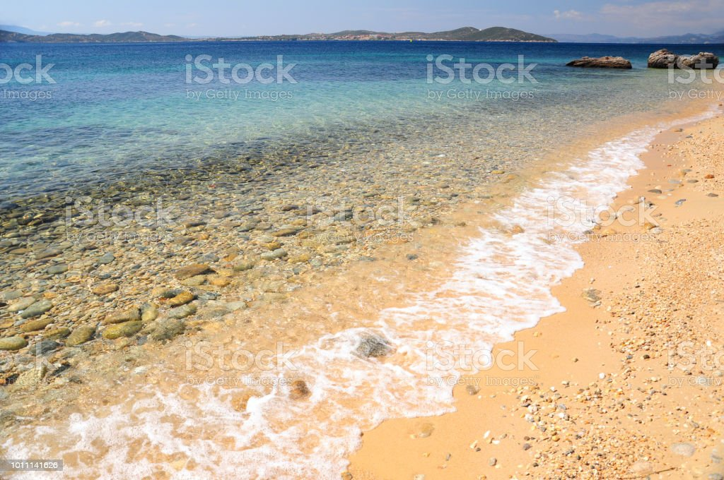Seascape of Aegean sea with wave at sandy beach of Athos peninsula, Chalkidiki, Greece stock photo