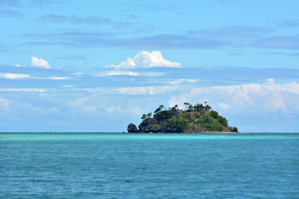seascape of tropical remote island in the yasawa islands group - desert island stock photos and pictures
