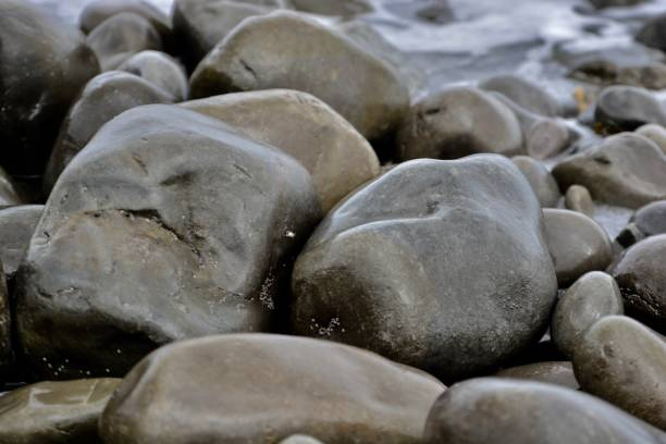 Seascape, rocks and pebble textures and background stock photo