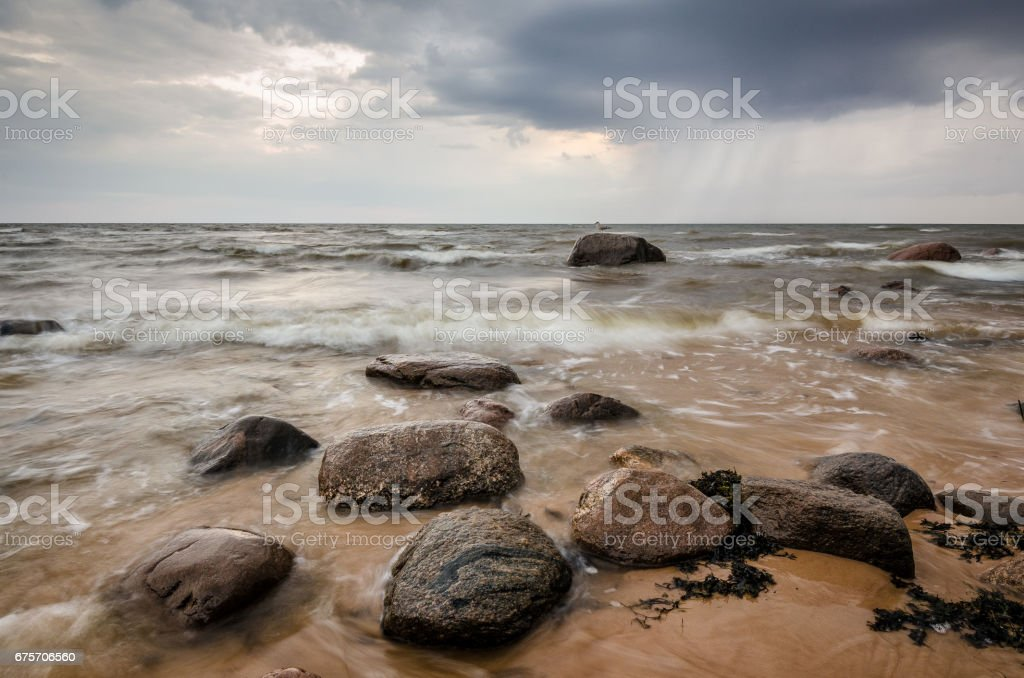 Seascape. Storm clouds gathering over the rocky beach. royalty-free stock photo