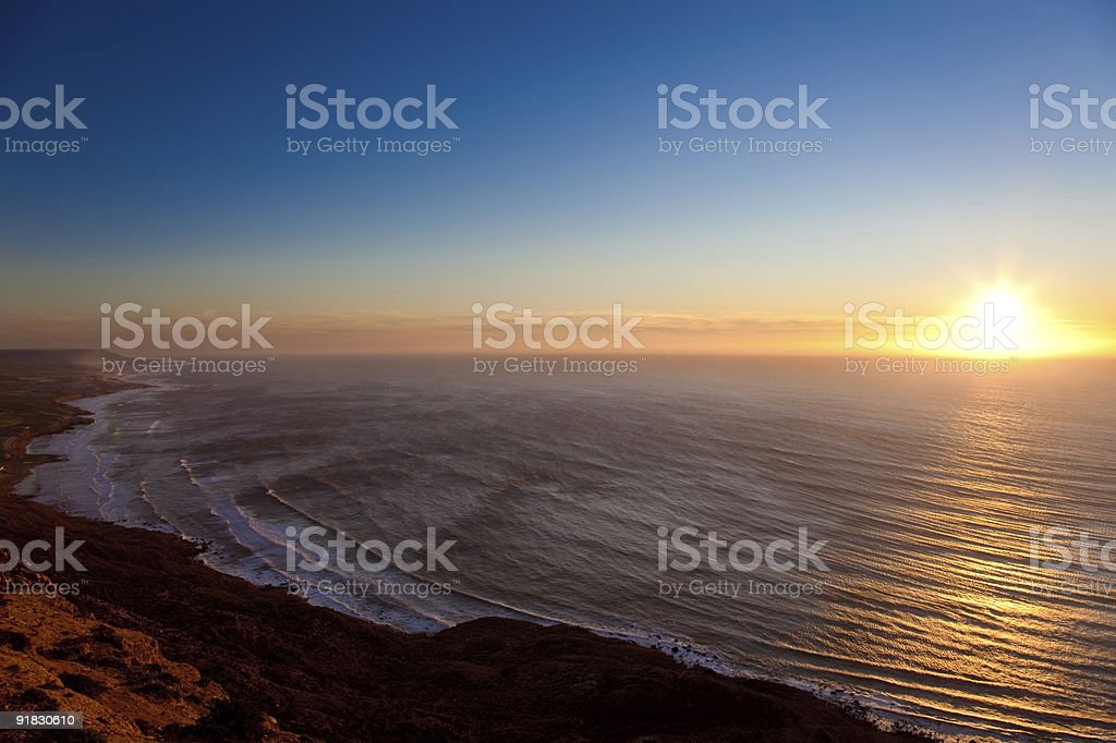 Seascape sunset from a mountain stock photo