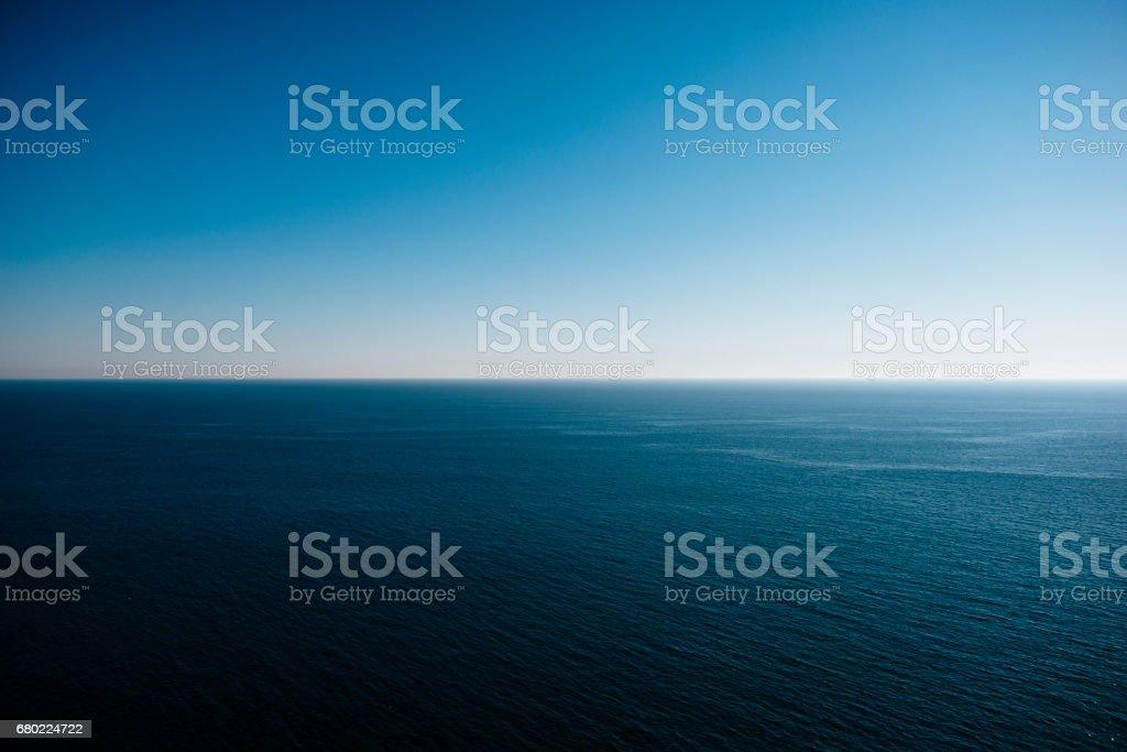 Seascape under blue sky stock photo
