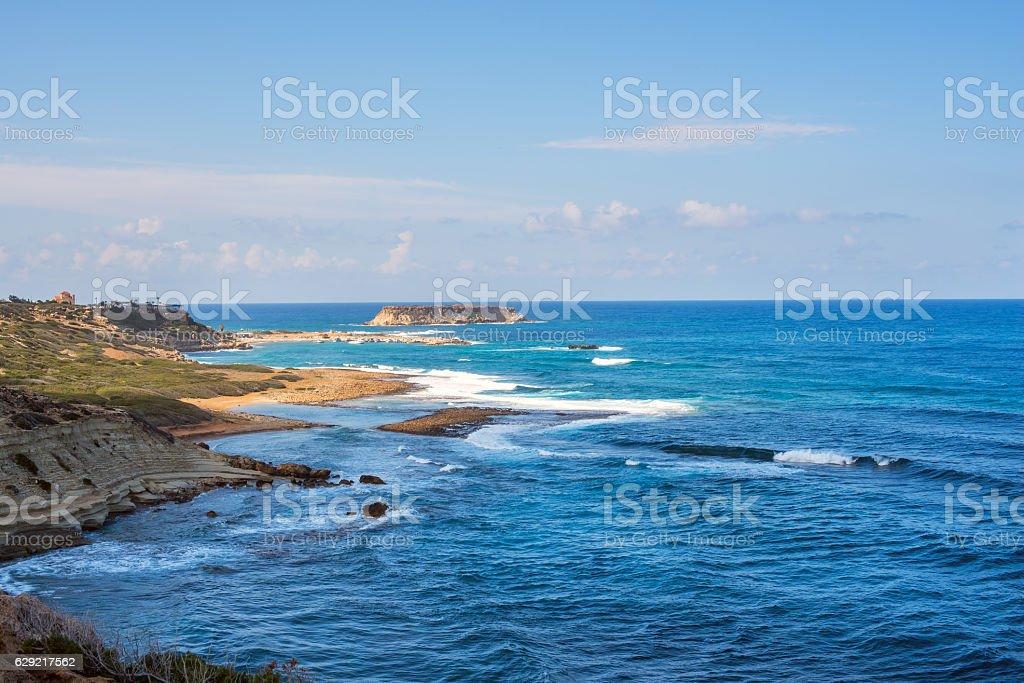 Seascape - waves crashing on the rocky coast stock photo