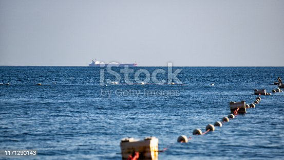 Merchant ship at sea on the roadstead and a fishing net