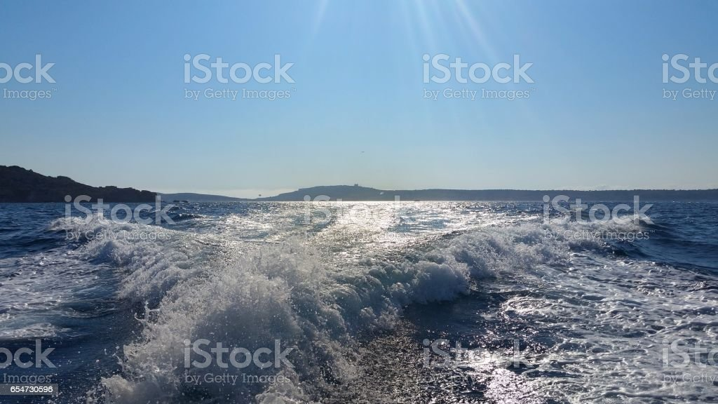 Seascape with a wake stock photo
