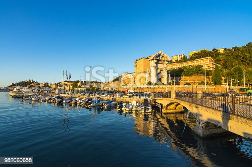 istock Seascape with Ancona harbor and boat docked at sunset, Marche, Italy 982060658