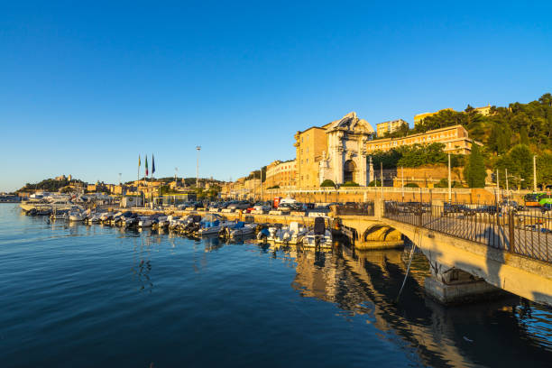 Seascape with Ancona harbor and boat docked at sunset, Marche, Italy stock photo