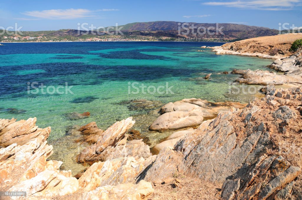 Seascape with clear turquoise water and rocks at foreground, Pena island, Chalkidiki, Greece stock photo
