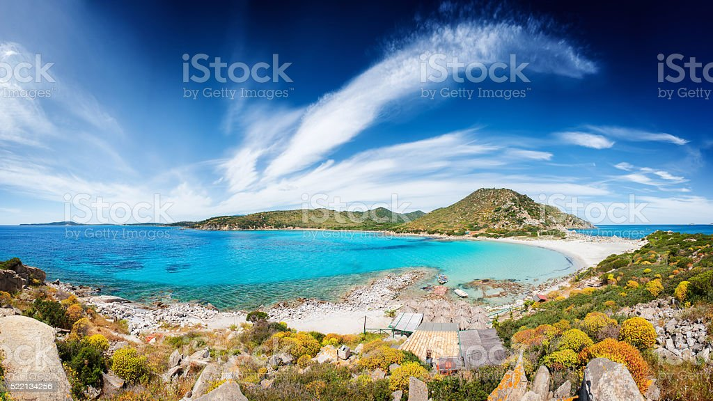 Seascape with deserted beach and crystal clear blue sea stock photo