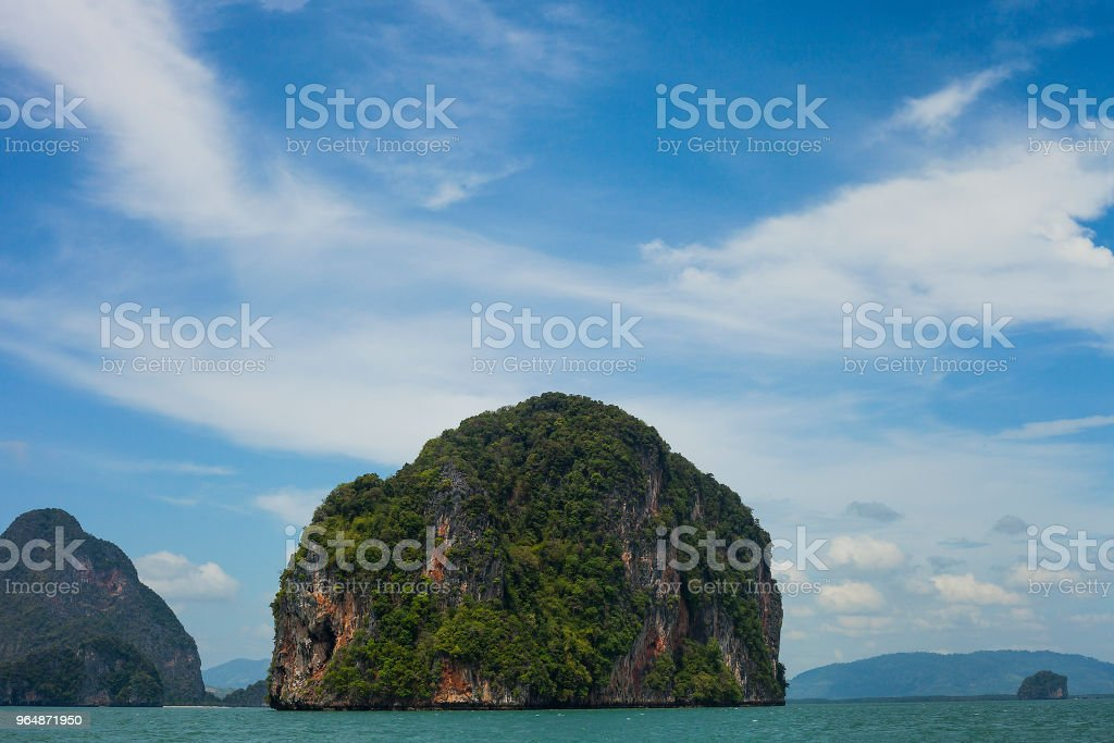 Seascape with green island against blue sky, Phuket, Thailand royalty-free stock photo