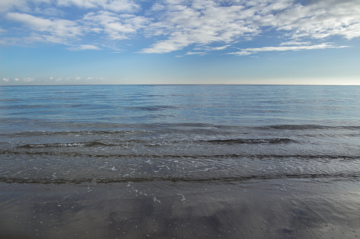 Seascape with stratocumulus clouds over horizon line