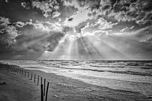 Seascape with sunbeams in black and white