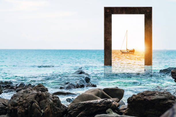 Seascape with wooden frame with sailboat and sunset stock photo