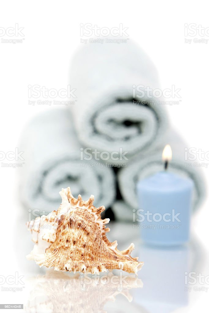 Seashell, towels and candle royalty-free stock photo