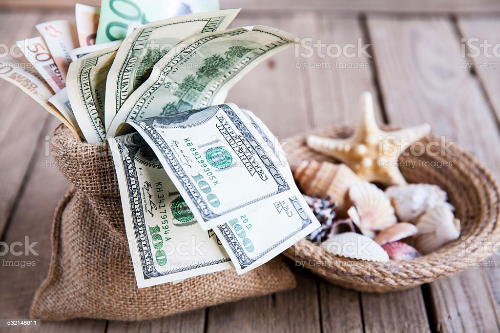 Seashells with money / holiday stock photo