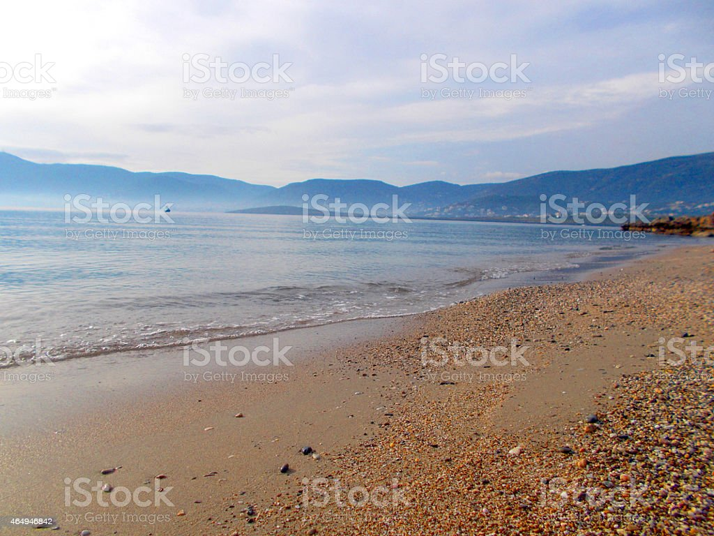 Seashoer with sand and pebbles stock photo