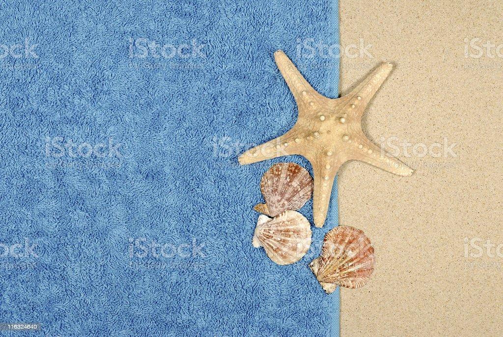 Seashore background with starfish and towel stock photo
