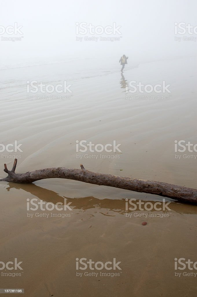 Seashore mist boy running royalty-free stock photo