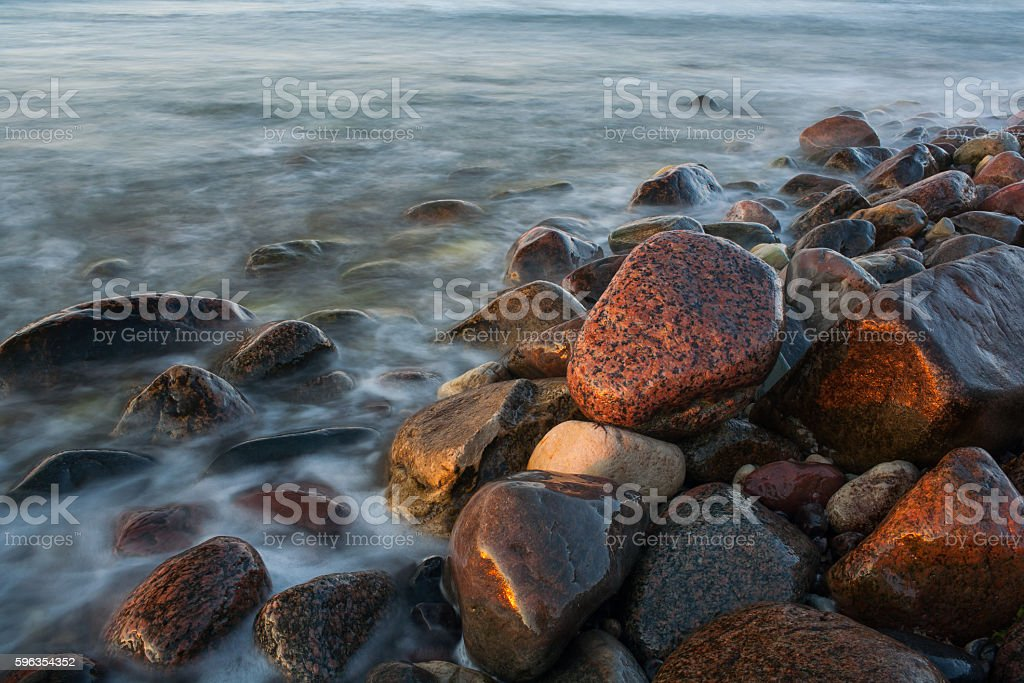 Seashore stones in sunset royalty-free stock photo