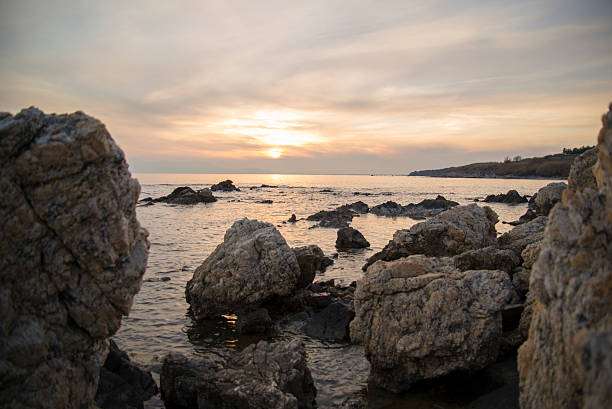 Seashore sunsets colors scenery stock photo