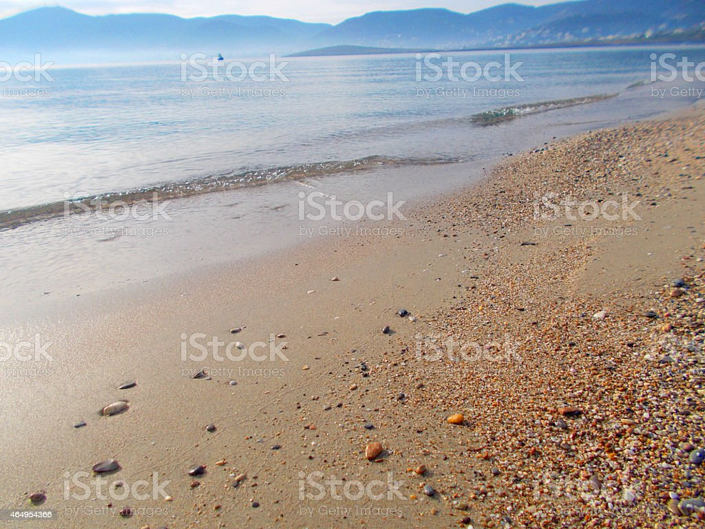 Seashore with sand and pebbles stock photo