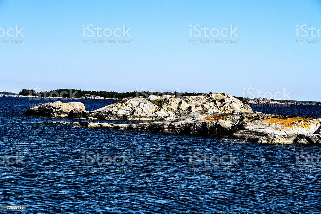 Seaside and stones by the water royalty-free stock photo