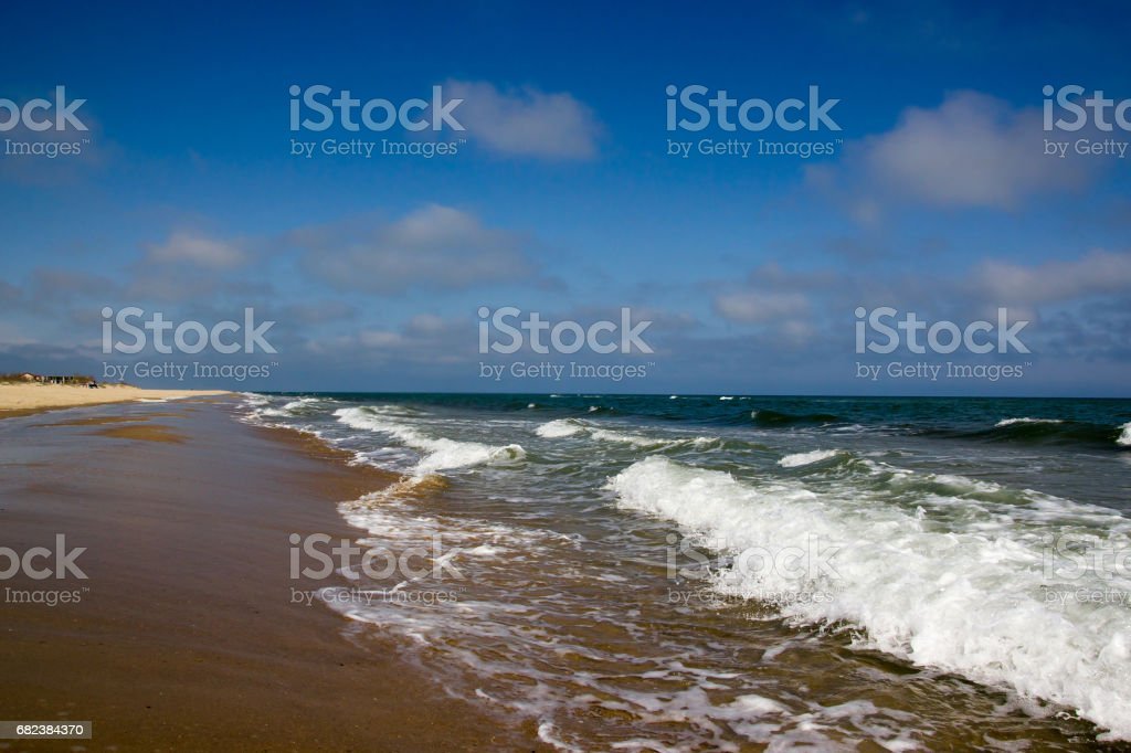 Seaside at day time with blue sky and clouds foto stock royalty-free