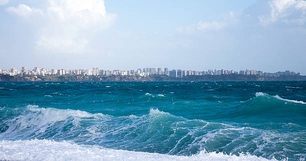 seaside city and waves stock photo