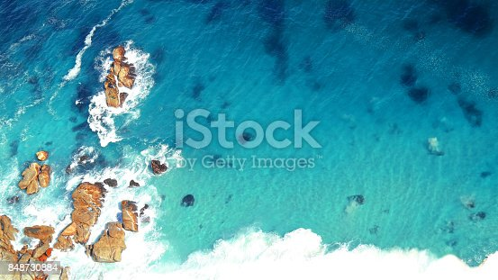 istock Seaside coastal rocky shoreline elevated viewpoint waves ocean tropical island 848730884