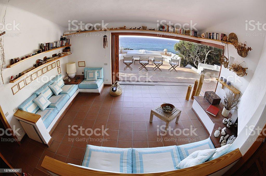 Seaside house living-room, terrace on the sea, glass open door stock photo
