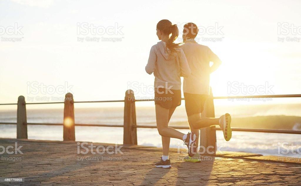Seaside jog at sunrise stock photo