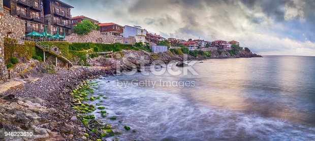 istock Seaside landscape, panorama, banner - embankment with fortress wall in the city of Sozopol 946223610