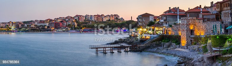 istock Seaside landscape, panorama, banner - view of the embankment with fortress wall during sunset in the city of Sozopol 934785364