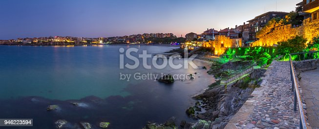 istock Seaside landscape, panorama, banner - view of the embankment with fortress wall during sunset in the city of Sozopol 946223594
