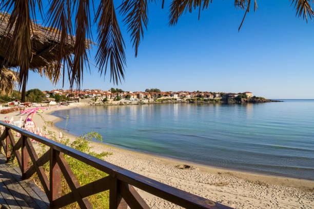 Seaside landscape - view from the cafe to the sandy beach with umbrellas and sun loungers Seaside landscape - view from the cafe to the sandy beach with umbrellas and sun loungers in the town of Sozopol on the Black Sea coast in Bulgaria bulgaria stock pictures, royalty-free photos & images