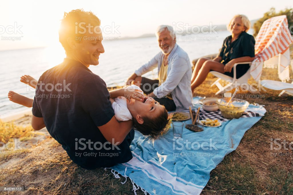 Seaside picnic with family stock photo