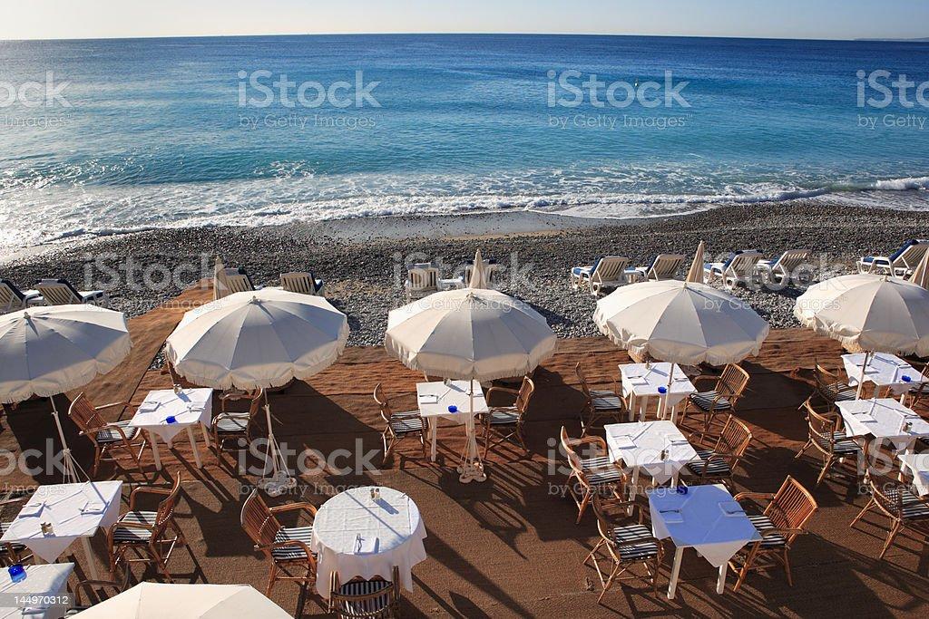 seaside restaurant at beach with sunshades stock photo
